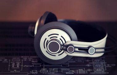Audio Stereo Headphones on the top of Vintage AmplifierTop View