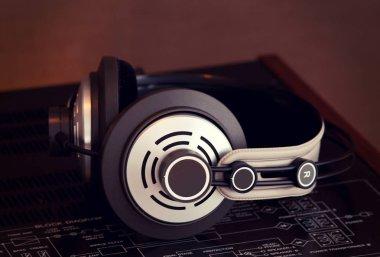Audio Stereo Headphones on the top of Vintage AmplifierTop View