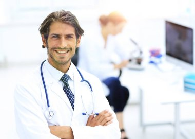 Successful happy smiling male doctor with phonendoscope stock vector