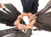 closeup.unified Business Team, gebunden ein starkes Seil.