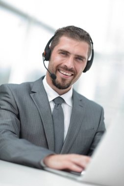Photo of a young agent of the call center with the headphones.photo with copy space stock vector