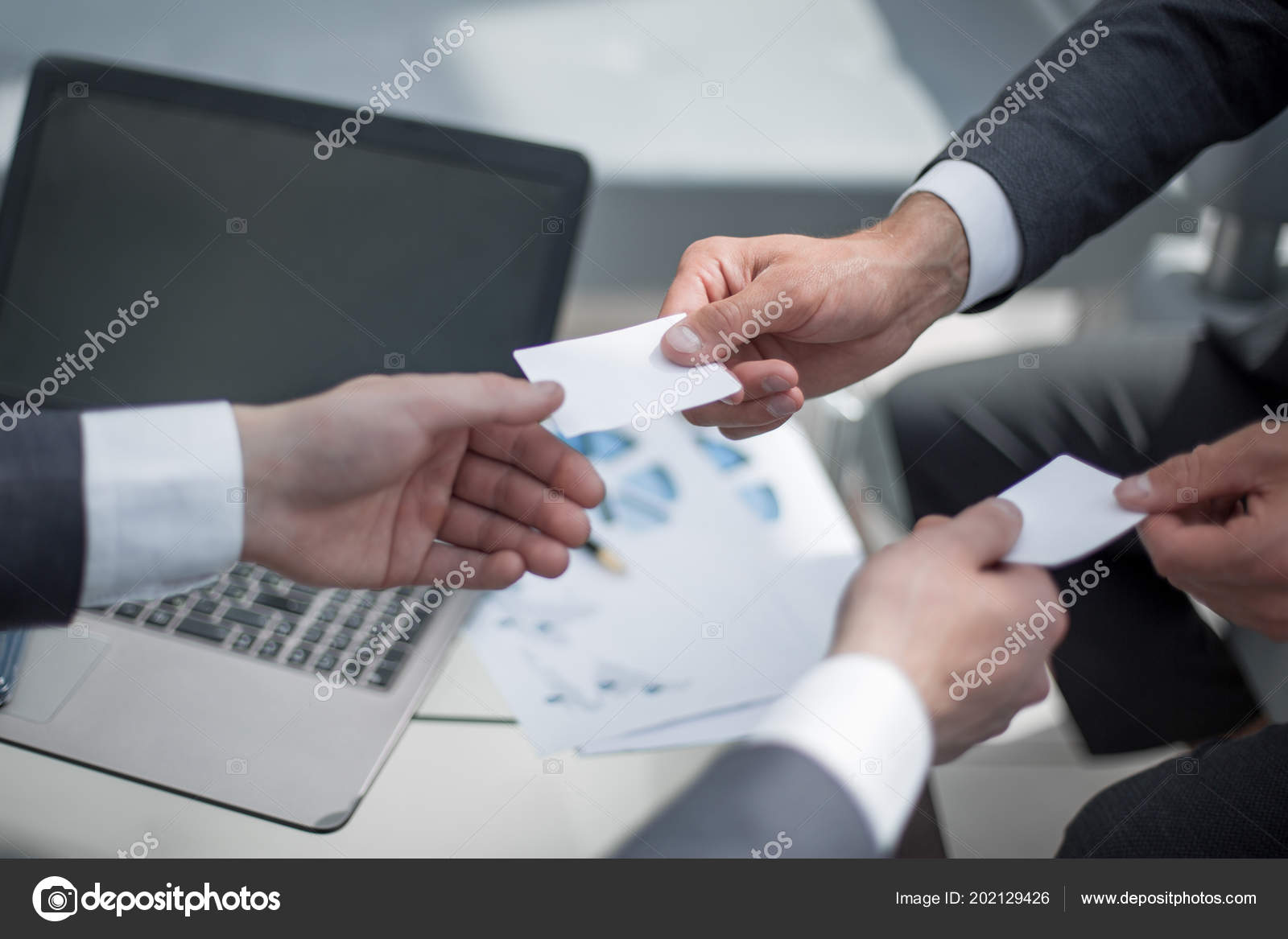 Close up people exchanging business cards stock photo close up people exchanging business cards stock photo colourmoves