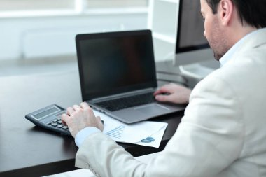 close up.Businessman analyzing investment charts