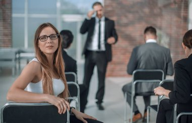 young businesswoman sitting in a meeting room
