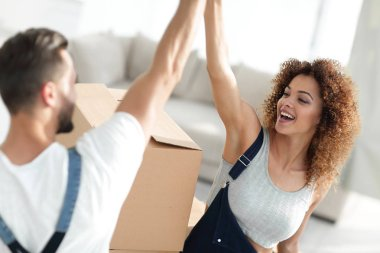 young couple giving five when moving to a new apartment