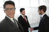 Fotografie businessman and handshake business partners standing in the office