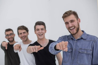 Young group of cheerful students pointing at you.
