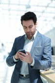 Fotografie close up.businessman looking at the smartphone screen