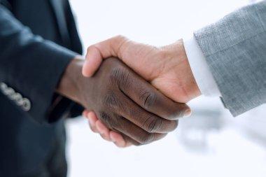 Business handshake in lofty office
