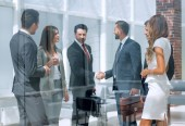 Photo handshake business partners in a modern office