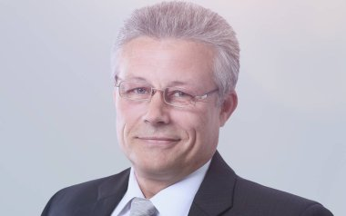 Portrait of a mature gray-haired  business man  isolated on gray