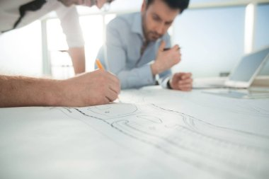 Close up.architects make sketches for a new project. photo with copy space stock vector