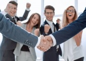 close up.handshake business partners on blurred office background.concept of cooperation