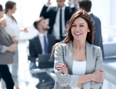 portrait of confident business woman on blurred office background