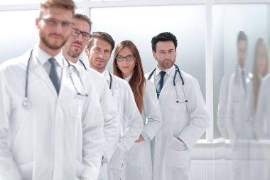 team of doctors standing in the hospital corridor
