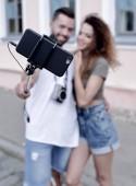 Fotografie Happy traveling couple making selfie, romantic mood.