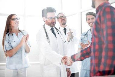 Thankful patient shaking doctors hand