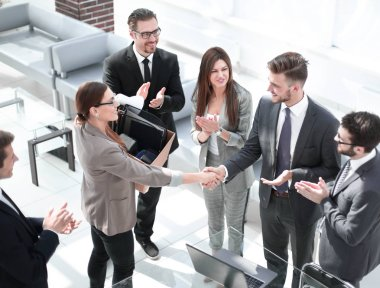 young business woman shaking hands with project Manager