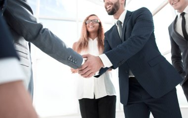 handshake of business partners at a meeting in the office