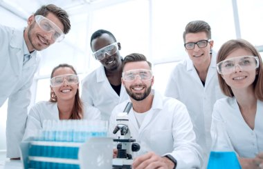 Group of Genetics engineering students working together in lab. Laboratory teamwork by college student indoors stock vector