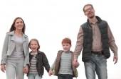 šťastní rodiče se svými dětmi navzájem ruce