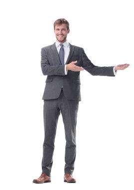 in full growth. businessman with a hand in a welcoming gesture.