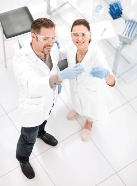 top view.happy scientists standing in the laboratory