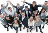 group of young business people celebrating their success