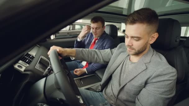 Bearded Guy Is Discussing Car Features With Salesman Sitting