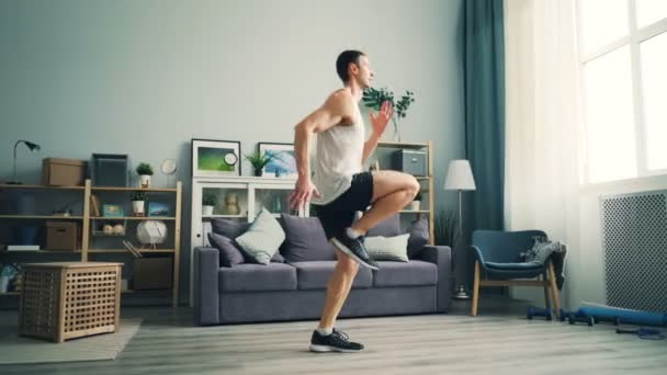 Professional runner exercising at home running on the spot doing cardio training
