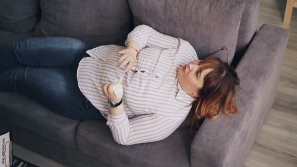 Obese patient young woman talking to psychoanalyst lying on sofa gesturing