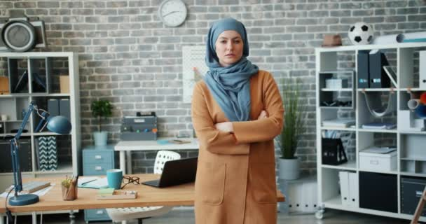 Middle Eastern business lady standing in office with serious face arms crossed
