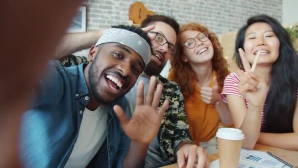 Smiling office workers multi-racial team taking selfie at work posing for camera