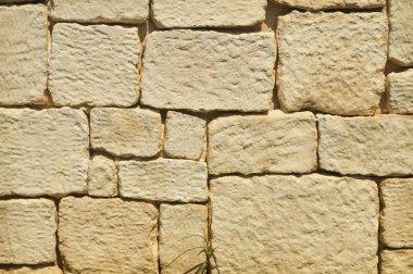 Old beige brick stone wall background