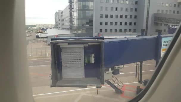Jet bridge coming to aiplane in airport.