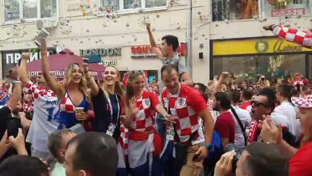People in Croatian national soccer team wear