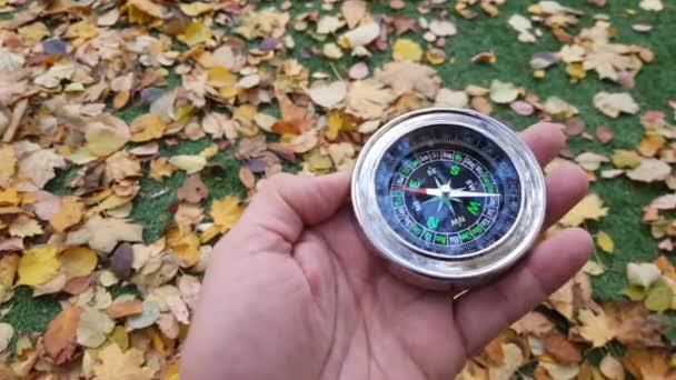 Man Holds A Compass And Points It To The North