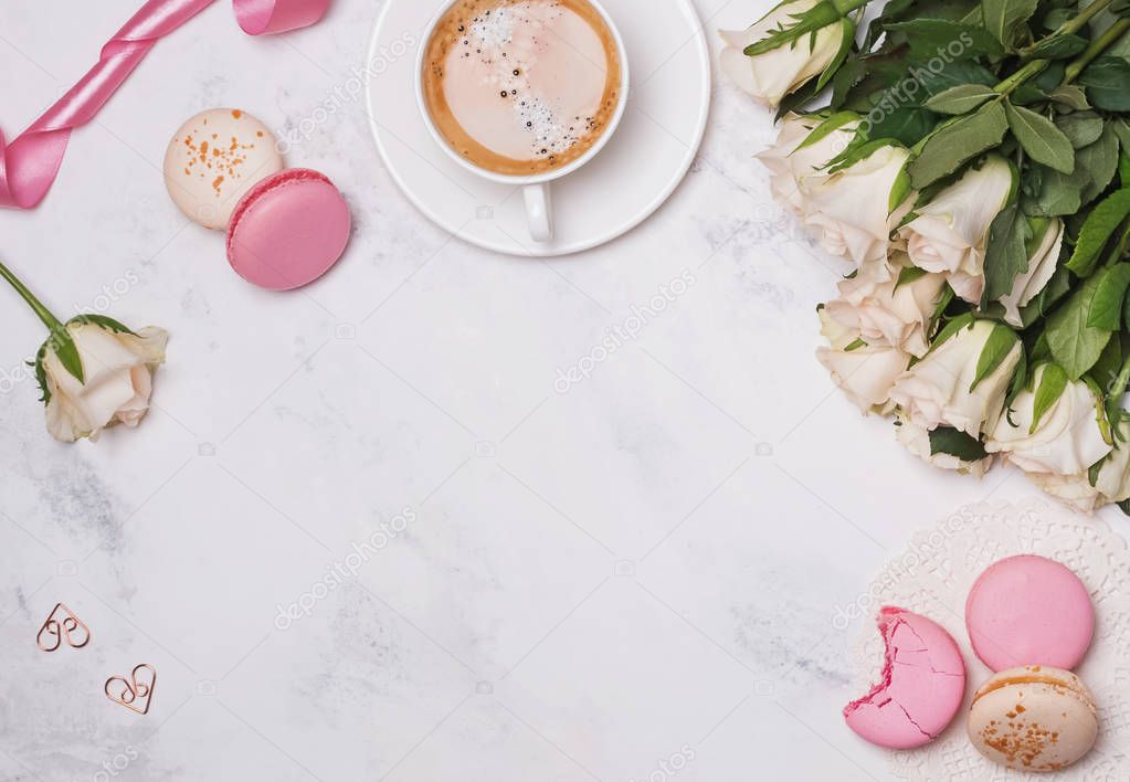 Flat lay with macarons, coffee and roses