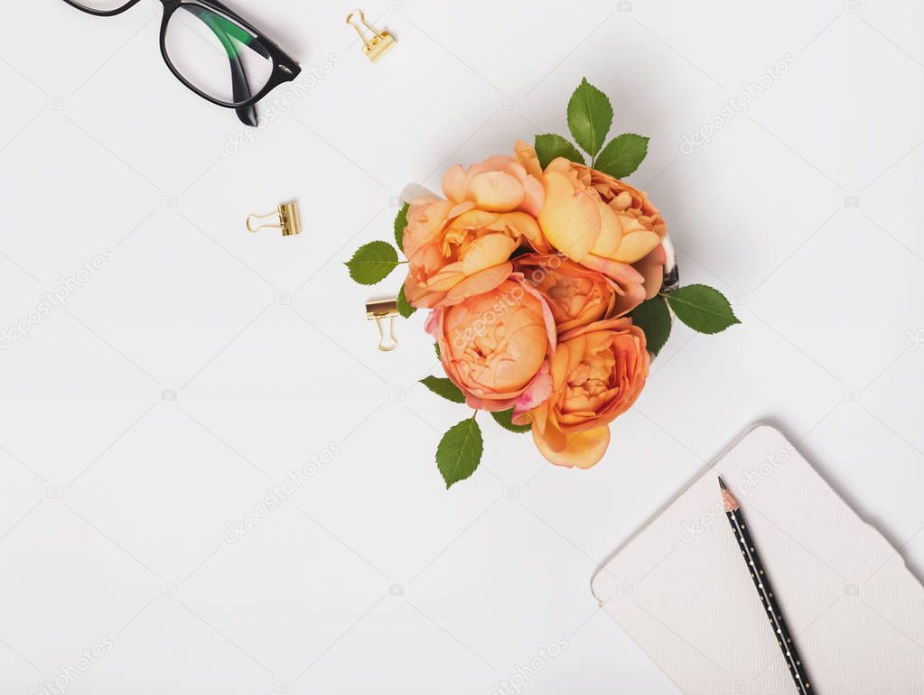 Flowers and glasses on the white background