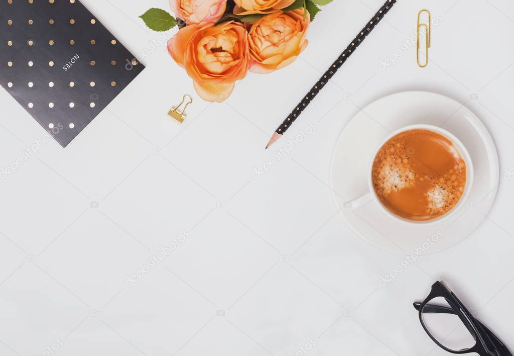 Coffee and roses on the white background, top view