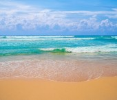 Fotografie Tropical ocean beach with yellow golden sand on sunny day vacation background.