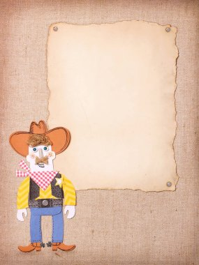 American Cowboy in wild west hat and boots on old paper background for text. Paper cut application