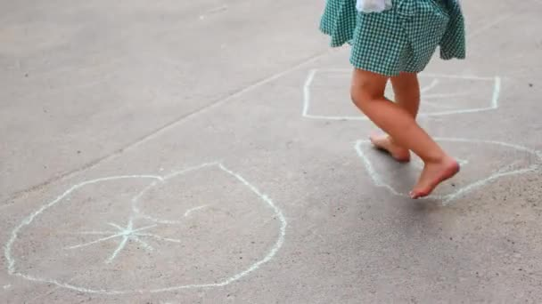 ULTRA HD 4K Young woman play hop scotch, girl jump hopscotch in summer holiday