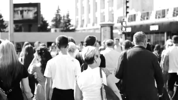 People go to the subway. Morning rush, crowd, black and white video