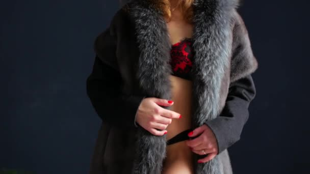 Beautiful woman in fur and lingerie. Close-up of lying sexy woman with perfect body in the fur coat.