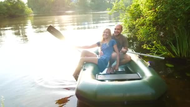 Couple in love on a boat in the lake. Beautiful romantic concept
