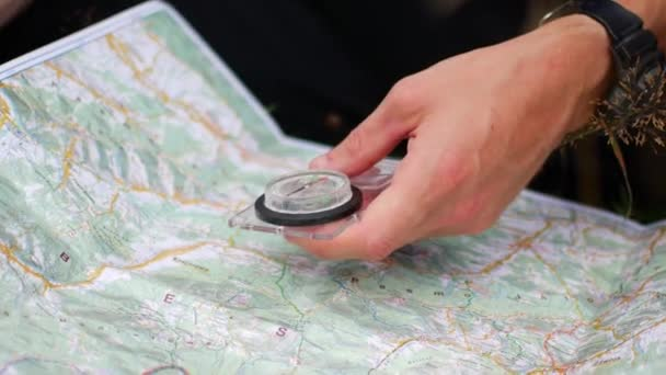 Compass and map. A tourist is looking for a route.