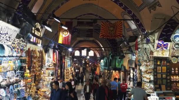 ISTANBUL, TURKEY - 3 MAY, 2018: World famous Turkish Grand Bazaar market. Historic area crowded with tourists walking around shops buying souvenirs.