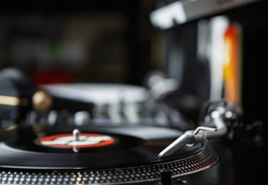 Professional party dj turntable.Analog audio equipment for parties & concerts.Play & mix music tracks on vinyl records player.Turntables needle cartridge scratch black vinyl record disc