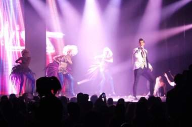 Editorial photos of famous Greek pop singer Sakis Rouvas performing on stage at buzuki in Athens, Greece on 13 of October 2012